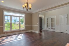Open family room with dark hardwood floors.