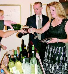Bottoms up at Travers Wine Tasting party - troyrecord.com