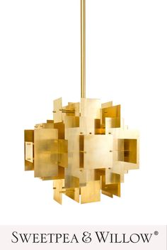 A glamorous take on industrial style, the modern and stylish Puzzle Chandelier is made of sheets of solid brass layered into a dynamic composition. The architectural, modernist feel is warmed up by the luminous antiqued brass. #sweetpeaandwillow #jonathanadler #brasschandelier #artdecolighting #homedecor Willow Furniture, Gold Furniture, Sweetpea And Willow, Ceiling Lamp, Ceiling Lights, Gold Home Decor, Modern Art Deco, Art Deco Lighting, Brass Chandelier