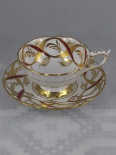 Royal Stafford Tea Cup Heavily hand decorated with gold and maroon ribbons No chips, beaks, or crazing In beautiful condition Tea Cup Set, Cup And Saucer Set, Tea Cup Saucer, Tea Sets, Fine Porcelain, Porcelain Ceramics, Porcelain Dinnerware, Painted Porcelain, Ceramic Art