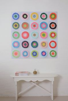 Inspiration - decorating with crochet images... an ixxi (company that makes decorative wall systems) crochet wall hanging... 25 unique crochet starburst rounds were photographed on a white paper background, cut and resized to the same size in Photoshop and then uploaded to the ixxi mainframe.