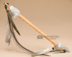 This is a very unique Native American Navajo style talking stick. In the Native American culture the talking stick was used to give each person in the circle a chance to speak with the respect of the