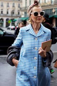 The Strand, London.  Love the coat and she looks confident.