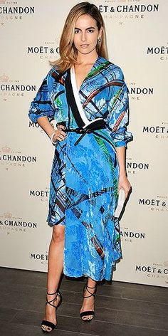 CAMILLA BELLE | in a colorful, printed Preen dress with an asymmetrical hemline and black bow belt, plus, lace-up Brian Atwood heels and a Lee Savage clutch