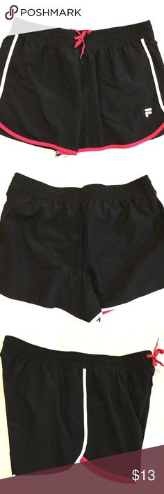 Fila Woman's Running Shorts Fila Woman's Running Shorts,Size XL Color Black with Pink and white stripes, This Item have been Worn but has no visible signs of wear in Excellent Condition. Fila Shorts