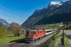 https://flic.kr/p/GCaeae | SBB Re 4/4 11199 | 11199 is hauling the Interregio from Basel SBB to Locarno. In the background the church of Silenen. April 30th, 2016