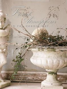 Love the white urn with twigs and branches