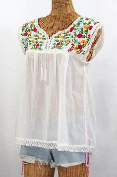 this website has a bunch of pretty embroidered Mexican Peasant Tops and  Blouses and their so cute and fashionable and stylish :) want a cap sleeve  version ...