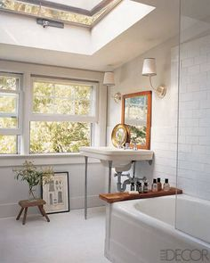 Updated 1920s -- subway tiles, pedestal sink, 2 sconces. Love the glass shower wall.