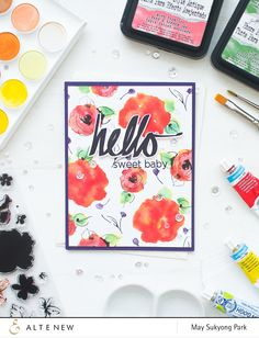 May created her own watercolor background with Distress Inks. She used mixed flower images from two different stamp sets: Painted Flowers and Vintage Flowers. How-to video tutorial included.
