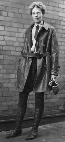 Amelia Earhart.  In order to fit in with the few female pilots in the US, Earhart purchased a leather jacket that she reportedly slept in for three days to give it the characteristic 'worn' appearance of other aviators. She also cropped her hair, and took to sewing her own clothes to ensure they were both feminine and practical.