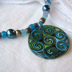 Items similar to Celtic Swirl Necklace, hand drawn shrink plastic charm w/ glass beads & synthetic pearls on Etsy Jewelry Crafts, Jewelry Art, Jewelry Design, Jewelry Ideas, Celtic Patterns, Celtic Designs, Artisan Jewelry, Handmade Jewelry, Unique Jewelry