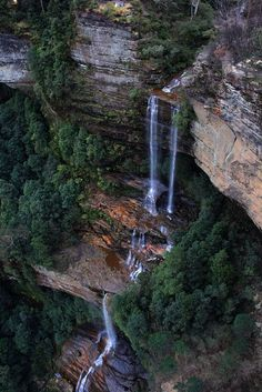 Katoomba Falls - Blue Mountains, New South Wales, Australia - A series of small waterfalls flow over rocks to the Katoomba Falls where it drops over 55 metres over the escarpment into the Jamison Valley below. The Places Youll Go, Places To See, Blue Mountains Australia, Small Waterfall, Les Cascades, Beautiful Waterfalls, Cairns, Australia Travel, Sydney Australia