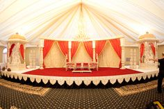Red and gold tented mandap. Photo by www.rhmphotography.com