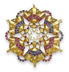A RETRO DIAMOND, SAPPHIRE AND RUBY 'ROCKETTE' BROOCH, BY JOHN RUBEL
