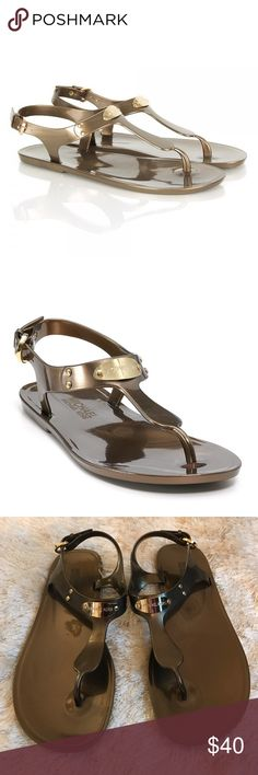 MICHAEL Michael Kors Jelly Plate Sandals Michael Kors jelly thong sandals in bronze. Excellent Used Condition, only signs of wear are on the bottom soles. Free box for safe storage. Offers Welcome 🙃 Michael Kors Shoes Sandals