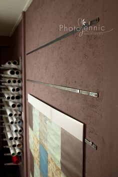 Magnetic Backdrop System - patterned fabric stiffened with iron-on material held to iron bars with strong magnets.