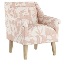 This little chair is too cute to pass up. Upholstered in a fun animal print with a tufted back cushion and wooden legs, it's miniature size was made just for stylish kids.