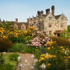 Gravetye Manor is a manor house located near East Grinstead, West Sussex, England.  The gardens are stunning. The manor became the home of the creative, innovative and revolutionary gardener, William Robinson in 1884 and reflect his soft flowing style of planting.