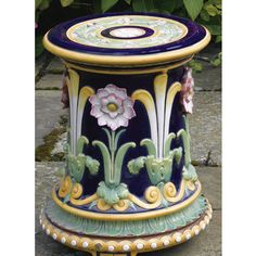 A Minton majolica garden seat circa 1868 moulded in high relief with passion flowers against a cobalt blue ground