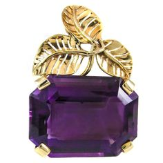 """1957 Rare Seaman Schepps Amethyst 14k yellow Gold Brooch with excellent craftsmanship of leaf details at the top, set with a radiant deep purple emerald- cut Amethyst. This piece was specially commissioned by H.Stern in 1957. The emerald-cut Amethyst is measured to weigh over 40 carats. -Amethyst measuring 25.4mm x 20mm x 12.6mm -1.5"""" long x 1"""" wide -Stamped Seaman Schepps, 14K , -16,2 grams- 10,4 dwt. •$2,850.00"""