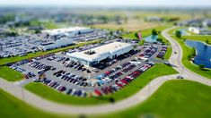#blur #building #business #cars #city #daylight #display #environment #field #grass #high angle shot #industry #lake #landscape #miniature #outdoors #parked #parking lot #road #technology #travel