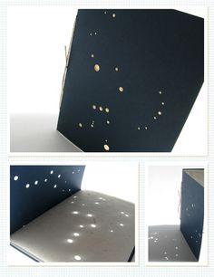 constellation cards, black construction paper with pin and punch holes and white paper inside to cast a showdown on