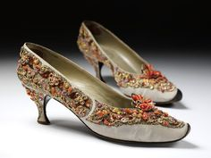 Pair of evening shoes    Place of origin:  Paris, France (made)    Date:  1958-1962 (made)    Artist/Maker:  Roger Vivier, born 1913 - died 1998 (designer)   Christian Dior (designed for)    Materials and Techniques:  Embroidered silk grosgrain with pastes, silver and gold metal thread, brilliants and beads