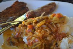 Braai - Chops and Maize meal with a tomato, onion and mushroom relish.  Mieliepap