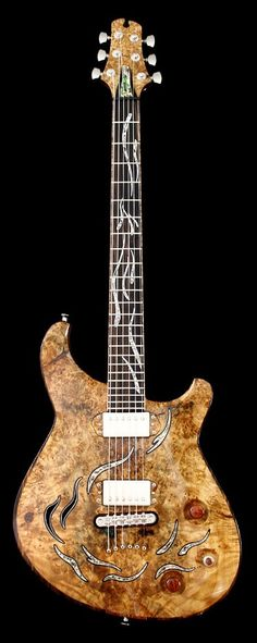 CROW HILL The Phoenix- Chambered Semi-Hollow Electric Guitar. RESEARCH #cSw:) - https://www.pinterest.com/claxtonw/4-5-6-strings/ - 4 5 6 STRINGS. Burl maple on morado and Spanish cedar, with wenge and maple accents incl binding. NECK: Five-piece, neck-thru of bubinga & morado, w wenge & maple accents. Mosaic mother of pearl and aluminum inlays.