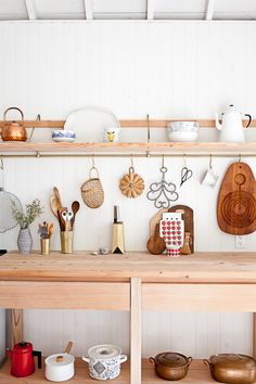 John and Juli Baker—some of the first to take full advantage of the kitchen utensil rail—installed a custom brass rail under the open shelves in their cottage kitchen. See more fromO Canada: Mjölk's Renovated Scandi-Style Cabin on a LakeandSteal This Look: A Scandi-Style Kitchen in a Canadian Cabin.