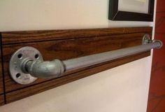 plumbers pipe as towel rod - for a masculine or industrial style bathroom
