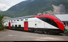 """The brand new double deck long distance train (""""FV-Dosto"""") for the SBB, RABe 502, in the Bombardier works Villeneuve during commissioning. Bombardier calls this 200 meter long 8 car trains for 200 km/h TWINDEXX Swiss Express. The aluminium body shells are built in Görlitz/Germany, the bogies come from Siegen/Germany, electric equipment from Västeras/Sweden, assembling of the intermediate cars and commissioning of the whole train is made in Villeneuve/Switzerland. This is the powered..."""
