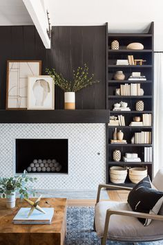 Neutral Living Room Design + Tribal Decor + Wood Coffee Table + Shiplap Fireplace + Diamond Pattern Tile + Black + Navy Rug + Modern Chairs + Trussed Ceiling + Open Wood Beam Ceiling + Built-In Storage | Lindsey Brooke Design