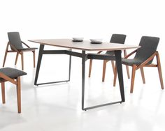 CENTURY DINING TABLE: A mid century modern inspired dining table constructed from a rich walnut veneer top and a powder coated steel base. The matching dining chair sits comfortably in a linen fabric and an exposed walnut wood frame.