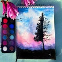 Tree watercolor with paints nearby