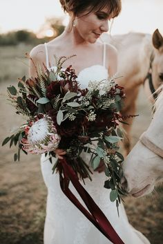 Wedding photo ideas // bride with horses // cascading floral bouquet // Natural Backyard Wedding in Fort Worth, Texas | Jessi + DustinNatural Backyard Wedding in Fort Worth, Texas | Jessi + Dustin