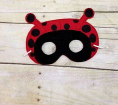 This little Childs Ladybug mask is just so cute. Felt masks are a wonderful way to promote imagination, and fun pretend play. Made with felt, and Machine Embroidered details, these sweet masks, are sure to be a hit as birthday party favors, sleep overs, or for classroom parties. Mask is approx. 5 x 7 across, with 2+ inch distance from eye to eye. Elastic is approx. 11 before stretch. I feed my elastic through, and hot glue for extra hold, so there is no fear of knot being pulled back out…