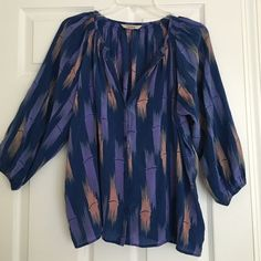 Tucker bamboo print blouse Loving the bamboo print! Semi sheer. Loose fitting, can fit a large. EUC. 100% silk. Buttons down the middle. Tucker Tops Blouses