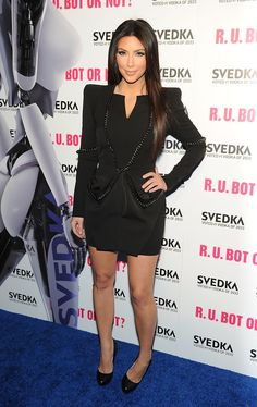 Television Personalitie Kim Kardashian and sister Kourtney Kardashian arrive to the Kim Kardashian Vs. Kourtney Kardashian At Svedka's Battle Of The Bots! at Wonderland on May 22, 2010 in Los Angeles, California.