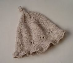 If you've been searching for that last minute baby shower gift, why not give this easy knit hat pattern a try. Made with a ruffled edge and peek-a-boo lace knitting, this charming Knit an Easy Baby Hat is ideal for a baby girl.