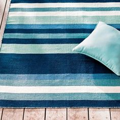 Our Somerset Outdoor Rug has earned its stripes as a rug for all seasons. Durable 100% polypropylene is built for indoor/outdoor versatility and designed to stand up to parties full of guests, all with a rich blue color palette and comfortable texture that endures for many happy seasons. Rugby-striped rug in cool blue palette Indoor/outdoor versatility 100% polypropylene If long ends appear, do not ...