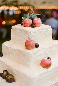 Brides.com: . A three-tiered square wedding cake topped with fresh apples and figs, created by Tod Dodson.