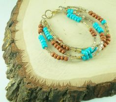 Multi-strand Bracelet of Wood and Turquoise dyed Stones by DavyJonesTreasures on Etsy https://www.etsy.com/listing/193030076/multi-strand-bracelet-of-wood-and