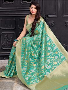 Designed with simplicity with a touch of soberness in its work makes a masterpiece. This turquoise silk classic saree add the sense of elegant and glamorous. The brilliant attire creates a dramatic canvas with amazing weaving work. Turquoise Fabric, Turquoise Color, Indian Designer Sarees, Designer Sarees Online, Indian Sarees, Party Wear Sarees, Festival Wear, Silk Sarees, Beautiful Athletes