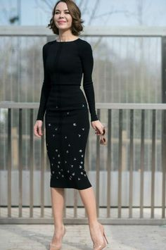 Ulyana Sergeenko street style outfit idea: Black long-sleeve shirt, beaded pencil skirt, and nude heels