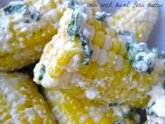 clambake inspired dishes: corn with basil feta butter