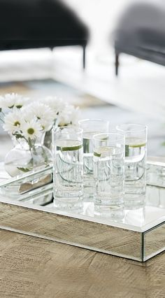 Shimmering mirrored-glass detail of the Small Mirrored Tray gives bar accessories a look of sophisticated elegance.
