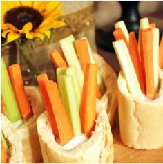 Individual appetizer servings of carrot and celery sticks in hollowed slices of french baguettes. Remove the bread centers halfway down to form a cup so the dip doesn't spill out.