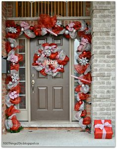 Christmas-ify your front door with a deco mesh wreath and garland. YouTube video tutorial included.